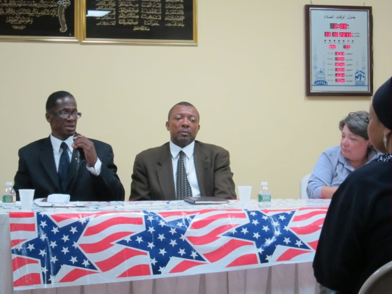 Mustapha Muhammad replies to a question from the audience as the other candidates listen