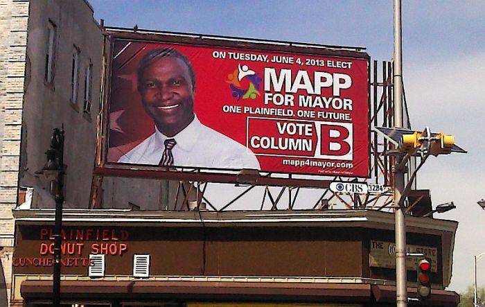 Adrian Mapp's billboard at E Second Street and Watchunge Avenues (photo by Dan Damon)