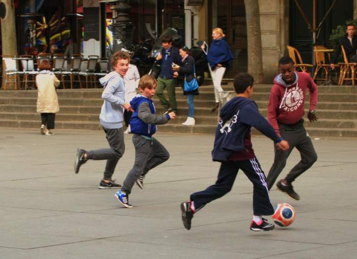 Some kids playing soccer near the Centre Pompidou