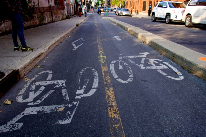 I love these bike lanes. In most cities, while bike lanes are safer, you are still one mishap from being hit. Not in Montreal, where curbs separate the bike lanes from the street.
